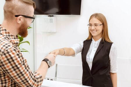 Happy customer is satisfied with the service staff Stock Photo