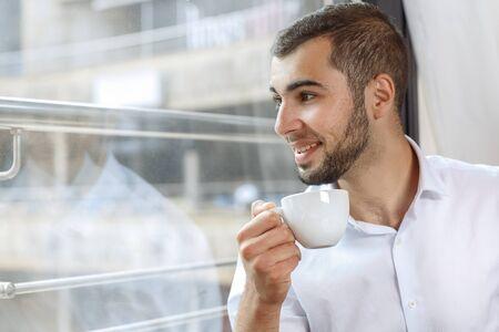 break in: Handsome businessman on coffee break in cafe Stock Photo