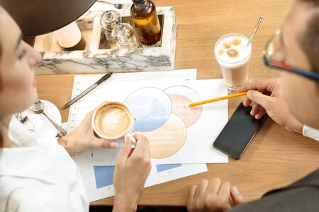 sales occupation: Business conversation between two business colleagues in cafe Stock Photo