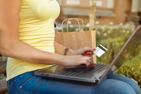 enters: Attractive girl enters into the computer data of her credit card