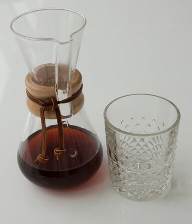 Chemex coffeemaker and glass on white background