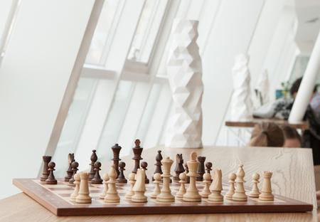 Chess standing on a shelf in a modern restaurant
