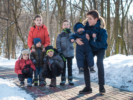 Adorable boys in winter park