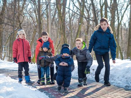 Funny little boys in winter park
