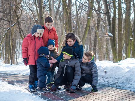 Cute children in winter park Zdjęcie Seryjne