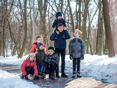 Group of little boys posing for camera in winter park