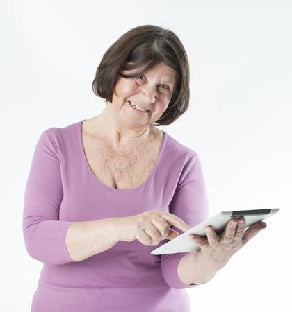 Elderly woman with tablet computer 版權商用圖片