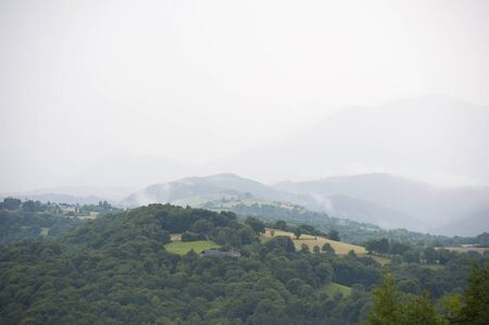 dank: Misty mountains in France. Region Midi Pyrenees. Shooting in the summer of 2014. France, the region of Central Pyrenees.