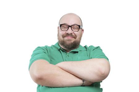 hombre con barba: Hombre sonriente satisfecho. Fotografía de estudio sobre un fondo blanco. Foto de archivo