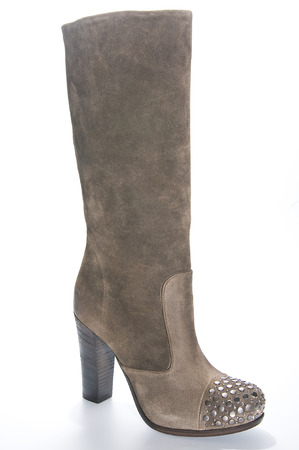clasp feet: Womens beige suede high-heeled boots. Studio photography on a light background. Stock Photo
