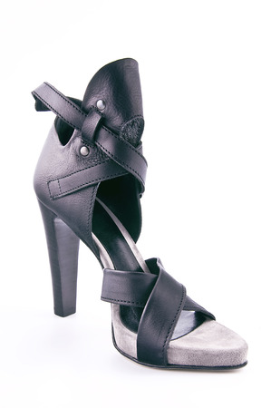 clasp feet: Womens leather shoes with high heels. Studio photography on a light background.