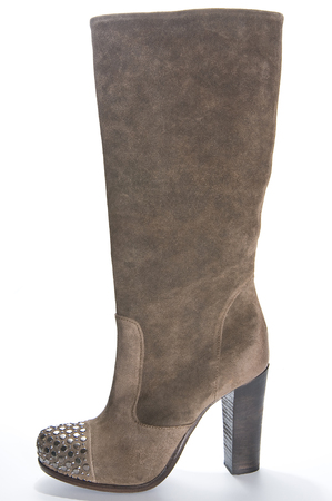 clasp feet: Womens brown suede high-heeled boots. Studio photography on a light background.