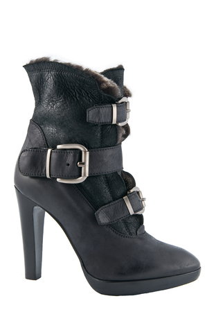 clasp feet: Womens winter boots with high heels. Studio photography on a light gray background. Stock Photo