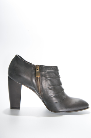 clasp feet: Womens leather ankle boots with high heels. Studio photography on a light background. Stock Photo