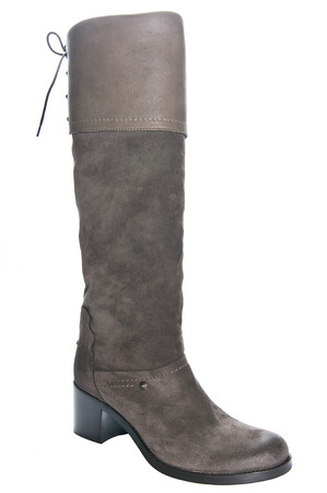 clasp feet: Womens brown leather boots on average heel. Studio photography on a light background. Stock Photo
