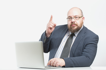 pay raise: Business man with a raised finger. Studio photography on a white (light) background.