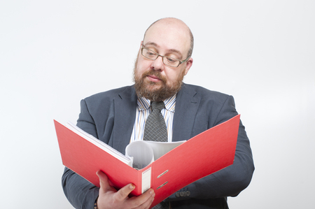 average guy: Business man studies folder with documents. Studio photography on a light (white) background.