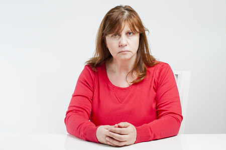strict: Strict middle-aged woman. Studio photography on a light (white) background. Stock Photo