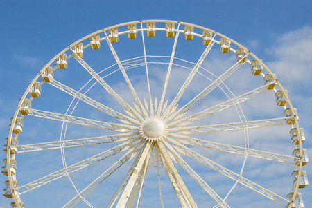 escapement: A fragment of the Ferris wheel. On a white background. Filmed on the island of Jersey in the summer of 2008.