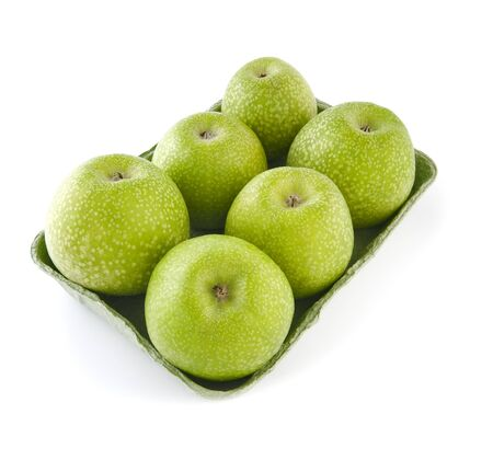 granny smith: Granny Smith apples in a tray on a white background. Studio photography on a white background. Stock Photo