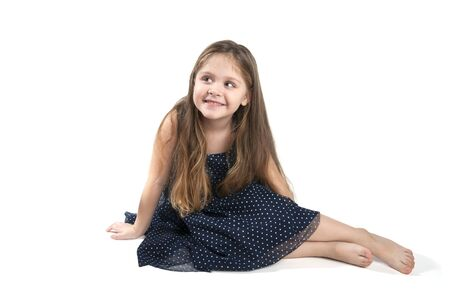 head dress: Little girl sitting on the floor on a pure white background. Stock Photo