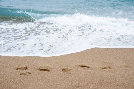 Sea, sand and footprints in the sand.Shooting on the beach of the Mediterranean Sea. 版權商用圖片