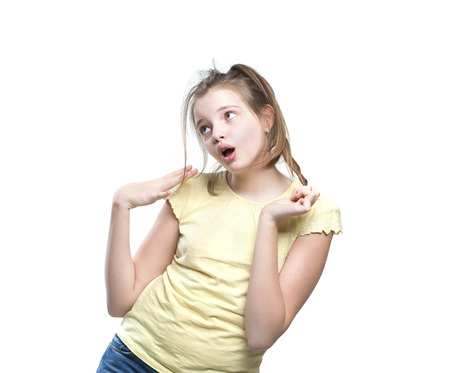 Flirtatious girl teenager. Studio photography on a white background. Age of child 11 years. Stock Photo