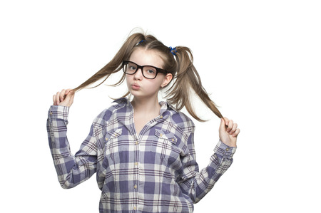 11 years: Teen girl in a plaid shirt. Studio photography on a white background. Age of child 11 years.