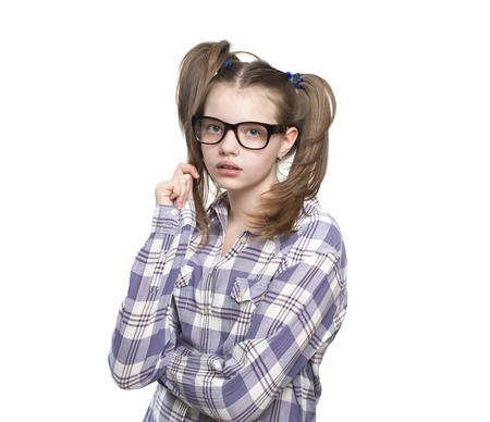 11 years: Portrait of teen girl in a plaid shirt. Studio photography on a white background. Age of child 11 years.