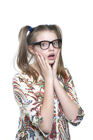 11 years: Surprised teen girl. Studio photography on a white background. Age of child 11 years. Stock Photo