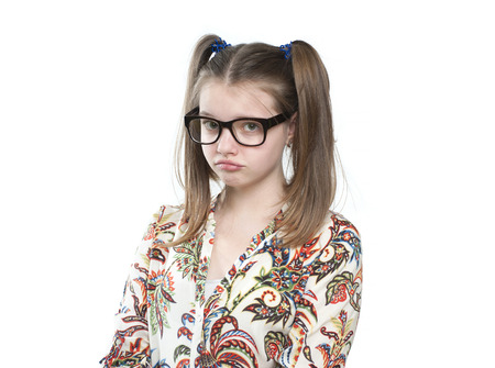 11 years: Offended teen girl. Studio photography on a white background. Age of child 11 years.