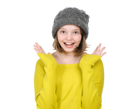 unexpectedness: Portrait of laughing (happy) teen girl in a knitted hat and bright jersey.