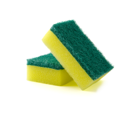 Two rectangular foam sponge for washing dishes or cleaning the house. Professional studio photography on a pure white background. Stock Photo