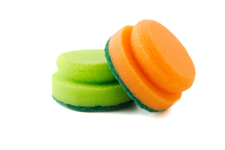 Two foam sponges for washing dishes or cleaning the house. Professional studio photography on a pure white background.