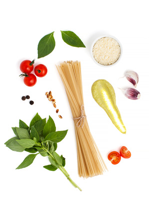 Ingredients for cooking spaghetti with Pesto sauce and tomatoes on a white background. Stock Photo