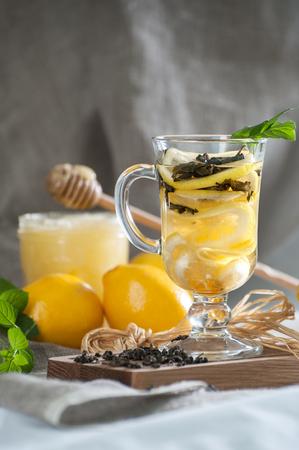 Freshly brewed lemon tea with fresh mint.