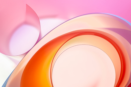 The background photo is colored rounded plates in close-up.