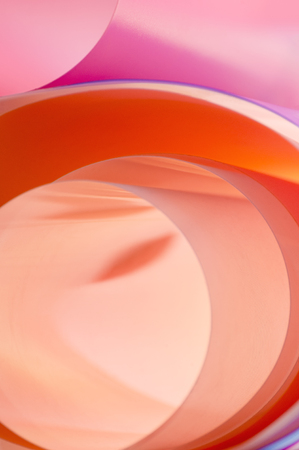 Pink-orange background of rounded elements with gradient intercoating colors. Vertical photo. Stockfoto