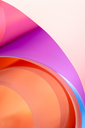 A close-up photo is a background of multicolored arcs with a gradient.