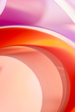 Multicolored background of rounded elements with gradient color overflow. Vertical photo. Stockfoto