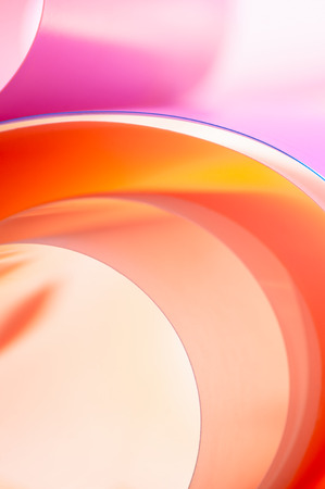 The background photo is a texture of multicolored arcs with a gradient.