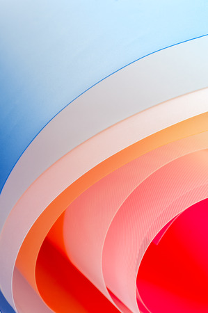 Art photography - background of multicolored twisted sheets.