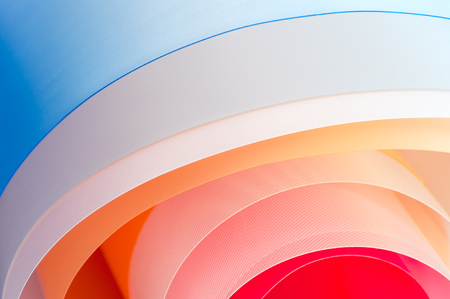 Background photography - multicolored twisted sheets with a gradient. Stockfoto