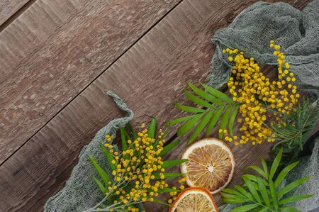 Old wooden table with mimosa flowers and leaves. Background image. 版權商用圖片