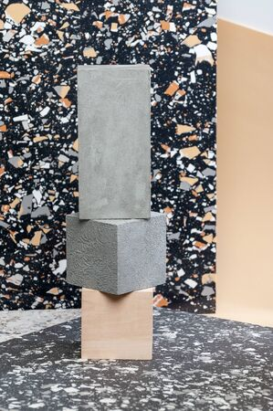Installation of geometric figures with concrete and wood coating on a stylish background.