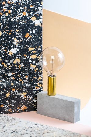 Installation of geometric shapes and lamps on a stylish modern background with a Terrazzo pattern.