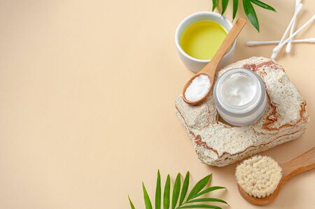 Cream and olive oil for body care. Background image with free space for text.
