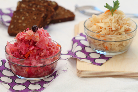 house ware: sauerkraut of two types: with carrots and with carrots, beet and blackcurrant Stock Photo
