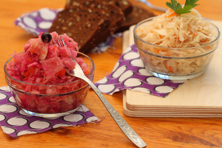 ware house: sauerkraut of two types: with carrots and with carrots, beet and blackcurrant Stock Photo