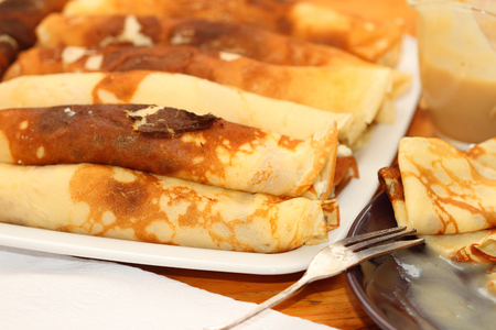 caramel sauce: two types of pancakes with a stuffing from cottage cheese with raisin and caramel sauce